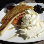 Pancakes, banana and cream with berries
