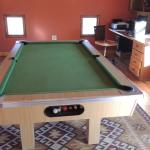 A small pool table at the first floor