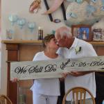 Renewing vows and celebration in reception area.