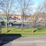 ASDA, buses & daffs in the Beckton sunshine.