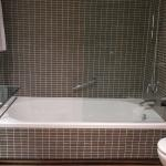 Comfortable beds, clean bathroom, and bathtub/shower of Standard Room at AC Hotel La Finca, Pozu