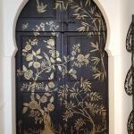stenciled side door to olive orchard