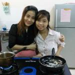 2 pretty and cheerful receptionists Huong and Ly preparing my breakfast.