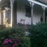 I relax in the rocking chair on the front porch
