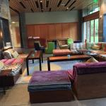 Comfy sitting area-Meeting rooms behind wooded panels