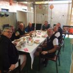 Golfing group enjoying Breaky together in BBQ area before hitting off.