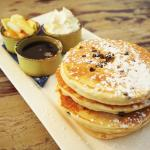 Chocolate chip pancakes, served with fruit, maple syrup and whipped cream