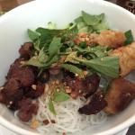 Grilled beef and Vietnamese spring rolls on rice noodle