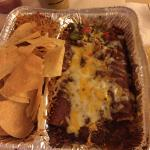 Supposed to be Beef enchiladas. Its just soggy slop. No taste. Rice so dry, I can barely swallow