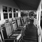 Lovely porch full of rocking chairs overlooking the Atlantic