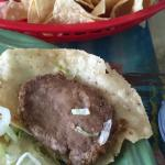 """Awful food--see the """"taco"""" meat. It was a dried portion of ref ride beans, I think. The salsa wa"""