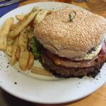A large burger, with a great chef-made meat pattie, bacon, egg