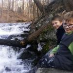 Boys by the waterfall