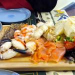 A seafood platter with a dish of mussels and (not quite in the picture) a dish of patatas brava