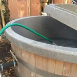Outdoor, wood fire heated hot tub - you fill yourself from hosepipe then start a fire and wait!