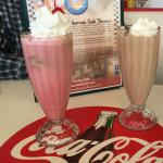 Ice cream soda on left (pink) and milk shake on right
