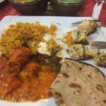 Plate of chicken biryani, Tantra chicken kabob, roti bread, and butter chicken