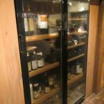 The wine case, next to the counter