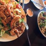 Chopped salad with crawfish and grilled shrimp on the left - chopped salad with chicken on the r
