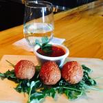 Yummy Happy Hour Arrancini with a cold glass of Reisling