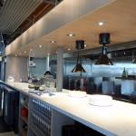 The open kitchen and food prep area