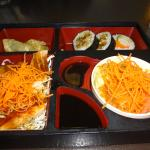 Salmon teriyaki bento box with sushi, gyoza