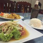 Spicy papaya salad, fish panang, and a Singha