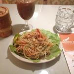 Papaya Salad with thai iced tea and side of steamed rice