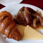 Croissant , cheese and sausages sauteed in onion