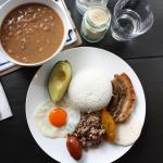 Bandeja Paisa: Our Colombian most famous dish made with beans, pork belly, chorizo, sweet corn,
