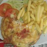 Cheese ham and mushroom omelette chips and salad