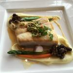 Spinach/cheese ravioli, halibut and sea bass entrees, rum-raisin ice cream, vanilla bean sauce,