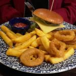 Mexican burger with chips and onion rings