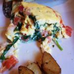 Personal omelette with tomato, shrimp and spinach
