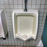 Urine on the men's room floor