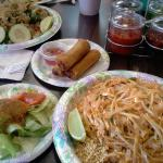 This is a picture of the Chicken Pad Thai, Basil Fried Rice, Spring Rolls and side salads.  Yumm
