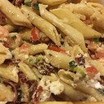 Delicious penne pasta with shrimp, goat cheese and sundried tomatoes