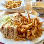 Club sandwich with fries & coleslaw plus onion rings.