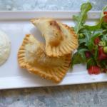 Beef, olive and cheddar empanadillas with side salad.