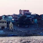 The hotel (the central red one) from the Ganges at dusk.