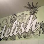 Our fantastic mural logo inside the shop, artwork by Beth Norling