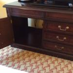 Useless old furniture, only bureau in room; with no drawers or shelves, and hole in back