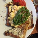Amazing scrambled eggs with crushed avocado with chilli flakes. Worth a try love it here