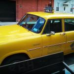 Classic NY cab outside front entrance. They actually use them for the free shuttle service.