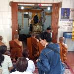 Devotees praying in the temple