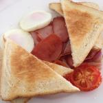 Bacon, tomato, toast & eggs for breakfast