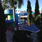 view of the pool area from an upstairs room balcony