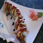 Cinta roll Inside: tempura crabstick, cream cheese, jalapeño Outside:salmon, avocado, sesame see