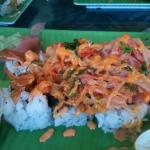 Del city roll with baked seafood on top