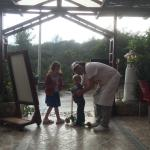 The owner playing with the children